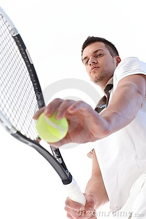 Young tennis player serving