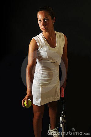 Young tennis pro about to serve