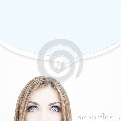 Young thoughtful businesswoman looking up at ideas symbols