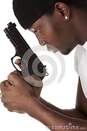 Young thug with a gun