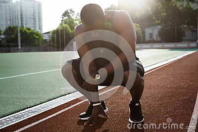 Young tired african male athlete finished running Stock Photo