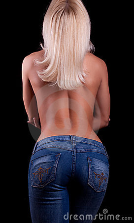 Young topless girl in jeans from behind