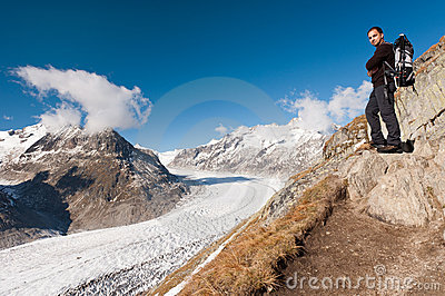 Young tourist near, Aletsch Glacier, Switzerland