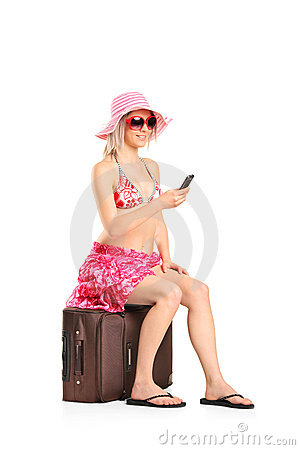 A young tourist woman typing a sms
