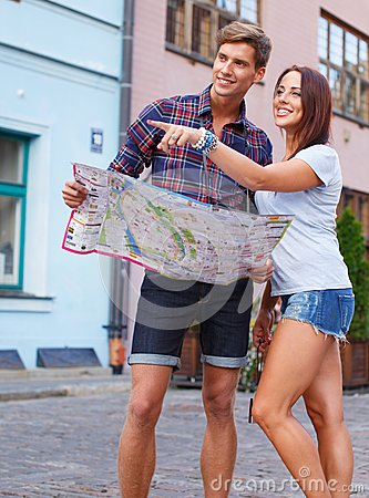 Young tourists with map