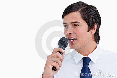 Young tradesman with microphone