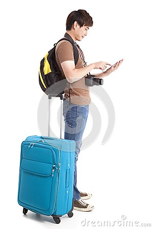 young traveler using tablet pc