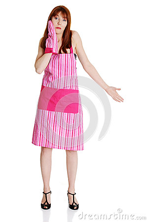 Young troubled housewife in pink apron