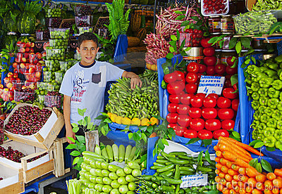 Young Turrkish boy holding vegetable stall Editorial Photography