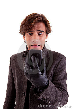 Free Young Unhappy Businessman Looking To Phone Stock Photo - 15764310