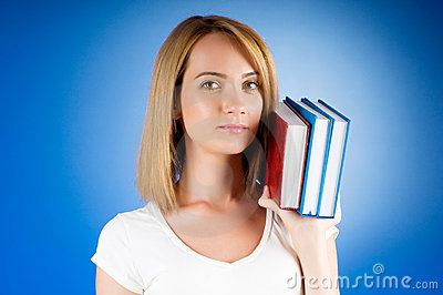Young university student with  study textbooks