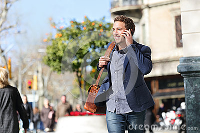 Young urban businessman on smart phone, Barcelona