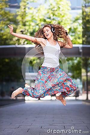 Young urban woman jumping