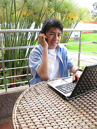 Young using laptop outdoors