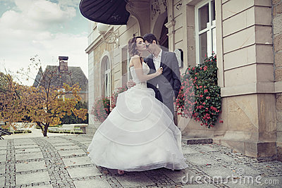 Young wedding couple dancing outdoor