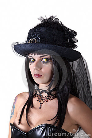 Young witch in veil hat