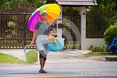Young womaan carying fresh bread to the local market Editorial Photo