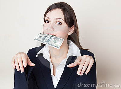 Young woman with 100 dollars in her mouth