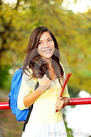 Young woman adult student in autumn back to school
