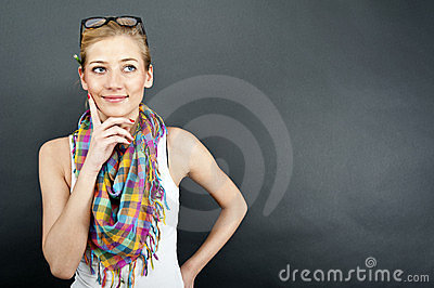 Young woman against the black background