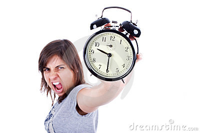 Young woman with alarm clock screaming