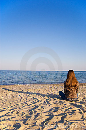 A young woman alone at the seaside