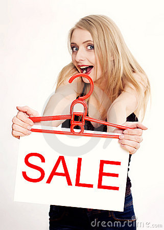 Young woman amazed by sale