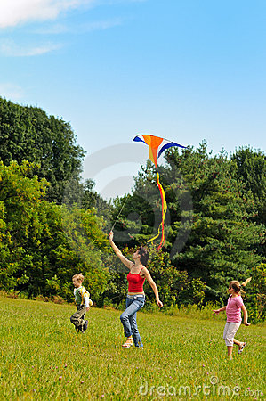 Free Young Woman And Children Flying A Kite Stock Photos - 16306423