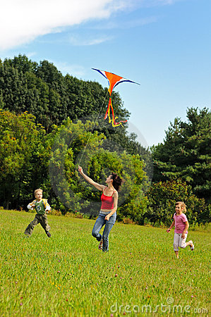 Free Young Woman And Children Flying A Kite Royalty Free Stock Image - 16306456