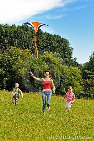 Free Young Woman And Children Flying A Kite Stock Photo - 16306490