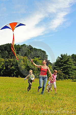 Free Young Woman And Children Flying A Kite Stock Photos - 16306523