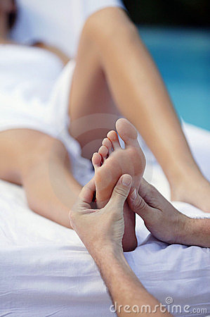 Free Young Woman And Foot Massage Stock Photo - 9074240