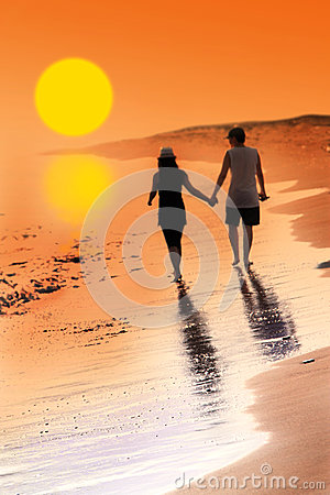 Free Young Woman And Man In Love Walking Hand In Hand On Beach With Beautiful Sunset Stock Image - 76869761