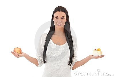 Young woman with apple and cake smiling Stock Photo