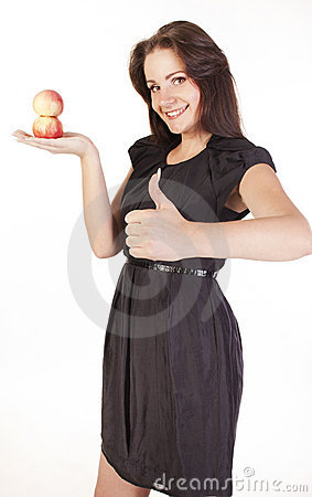 Young woman with apple showing hand ok s