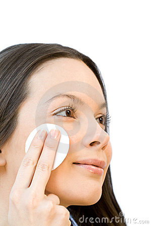 Free Young Woman Applying Face Cotton Pads Stock Photo - 3994750
