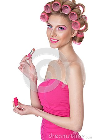 Free Young Woman Applying Lipstick Royalty Free Stock Photos - 100798578