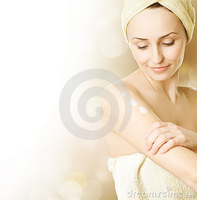 Free Young Woman Applying Moisturizing Cream Stock Photos - 13541423