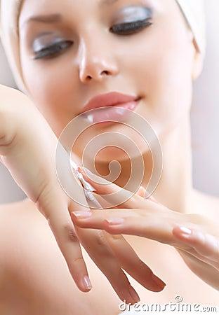 Young Woman Applying Moisturizing Cream