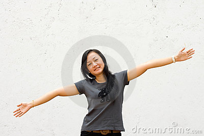 Young woman with arms wide open