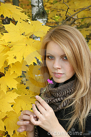 Young woman in autumn forest