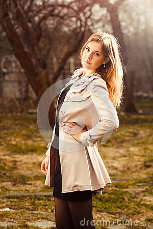 Young woman in autumn garden