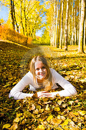 Young woman on the autumn leaf