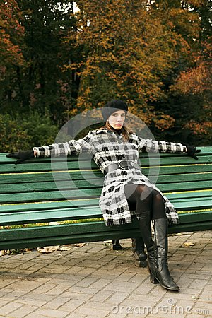 Young woman in autumnal park