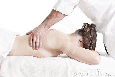 Young woman back massage spa