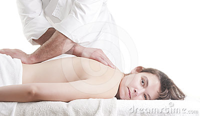 Young woman back massage spa