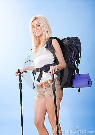 Young Woman With Backpack And Jogging Sticks Stock Photo - Image: 23546080
