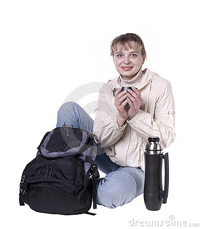 Young woman with backpack and thermos resting
