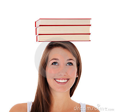 Young woman balancing books on her head