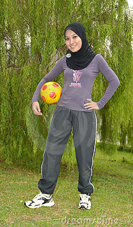 Young woman with ball